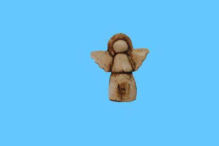 Ceramic angel on background Stock Photo