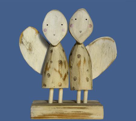 two wooden angels. primitive art Imagens