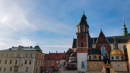 Domes of two Renaissance chapels on the side of the cathedral on Wawel Hill in Krakow Poland. Polands monarchs used to be crowned here. The chapel with the golden dome is Kaplica Zygmuntowska Imagens