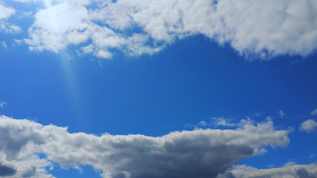 Beautiful blue sky with and sun. Sky with clouds and the sun. Weather nature cloud blue