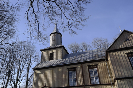 Old Lithuanian Wooden catholic Church. Renaissance Lithuania Chapel Made Only Of Timber Logs And Boards