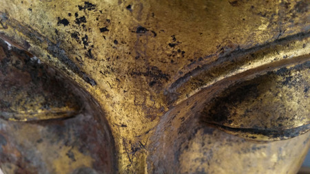 closeup big buddha eye. image of an old sculpture