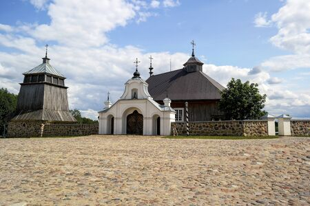 Wooden church on a sunny summer day in Lithuania.