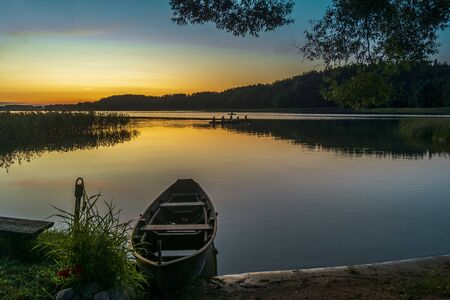 Sunset and old wooden fishing boat. European travel