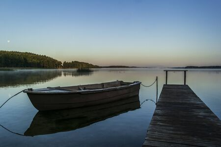 Morning and old wooden fishing boat. European travel