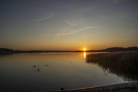 Beautiful summer sunset on the lake. Euro-trip Reklamní fotografie