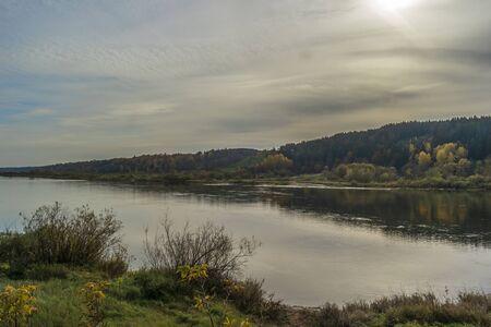 Autumn nature river landscape. Forest river in autumn.