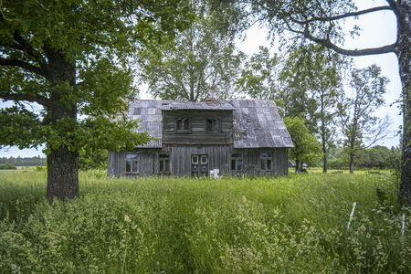 Old deserted wooden farm house in East Europe.