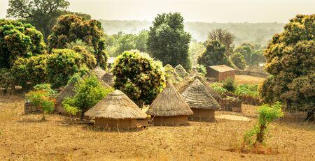 Traditional Bedik tribe bungalows in Senegal, early morning. Standard-Bild