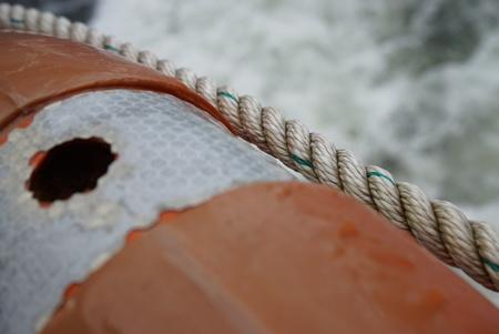 lifesaving: Lifesaving float installed on the boat cruising along Milford Sounds Stock Photo