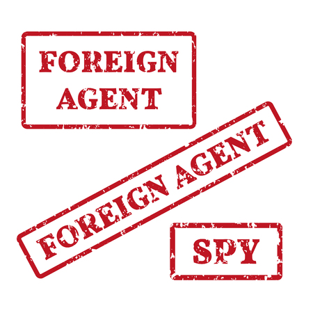 A grunge rubber stamps: spy, foreign agent. Vector illustration. Çizim