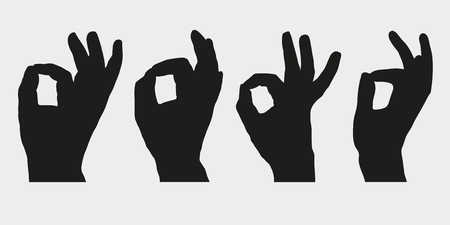 Set of silhouettes of hands showing symbol OK, All right or Very good.