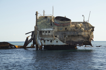 down beat: body of the dead ship stranded on a reef