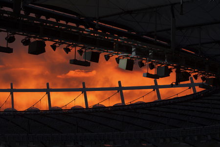 suspend: silhouette of the stadiums roof at sunset