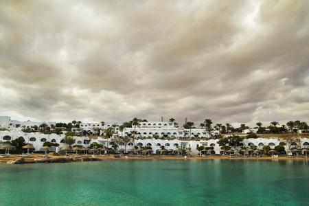 el sheikh: Resort at the salt lake under the storm sky. January 2015. Egypt, Sharm El Sheikh. Stock Photo