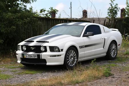 mustang gt: KONSTANTINIVKA, UKRAINE - JULY 28 2015 - sport car Ford Mustang GTCS parked in village on July 28, 2015 in Konstantinivka. Editorial