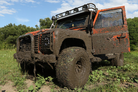 defender: UKRAINE - JULY 28 - very dirty car Land Rover Defender after the race on July 28, 2015 in Ukraine.