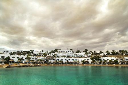 el sheikh: Resort at the salt lake under the stormу sky. January 2015. Egypt, Sharm El Sheikh. Stock Photo