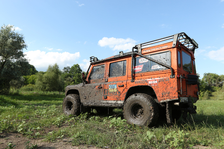 defender: UKRAINE - JULY 28 - very dirty Land Rover Defender on a glade on July 28, 2015 in Ukraine.