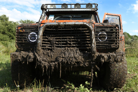 snoot: UKRAINE - JULY 28 - fornt side of Land Rover Defender in nature covered in mud on July 28, 2015 in Ukraine.