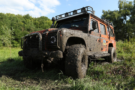 smutty: UKRAINE - JULY 28 - Land Rover Defender in nature covered in mud on July 28, 2015 in Ukraine. Editorial