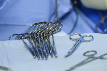 cu: sterile surgical instruments - Kochers clamps prepared for the surgery lying on the table Stock Photo