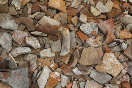 spall: Heap of antique ceramic shards background