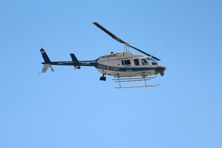 chasing tail: Police helicopter in flight in Israel Editorial