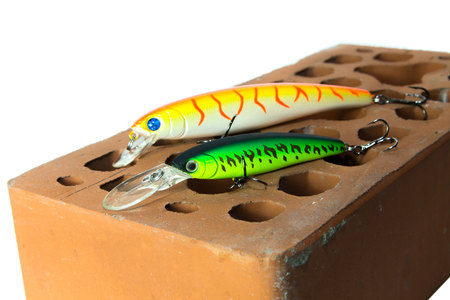 bait: Two bait on a brick background. Bait for pike. Stock Photo
