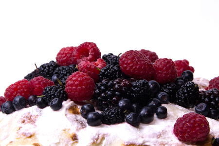 The top of the cake with berries. Wild, home berries.