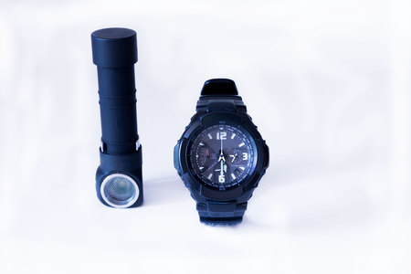 The clock is half past five. Man attributes. Military clock. Military knife Military flashlight