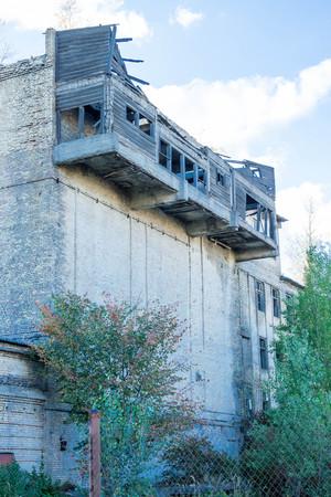 Devastation. Dangerous building Destroyed building. Woden balconies.