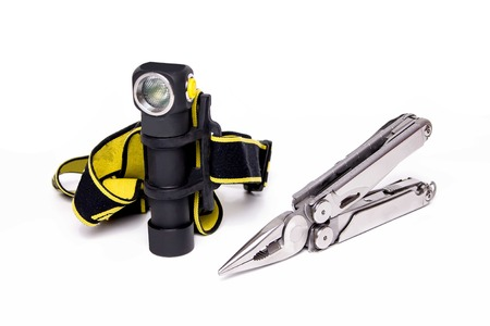 Knife and headlight. Multi-tool for outdoor. Flashlight for hiking. Hiking.