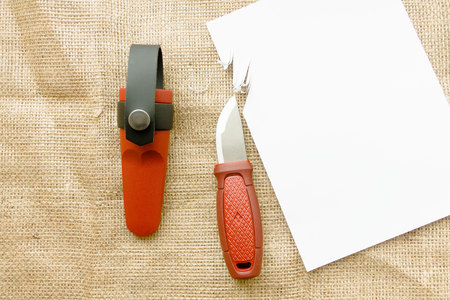 Testing the sharpness of the knife. Checking knife sharpness. Stock Photo