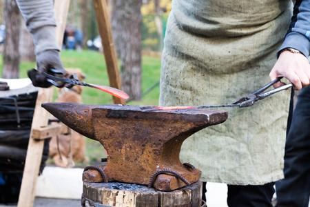 steelmaker: Forging a knife. Stock Photo