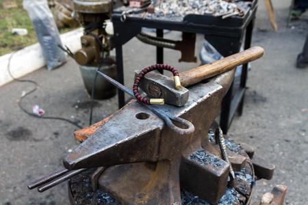 steelmaker: Anvil, bracelet and hammer.