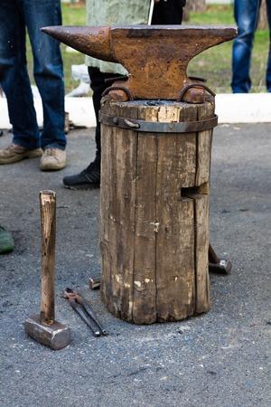 steelmaker: Anvil, hammer and a tree stump.