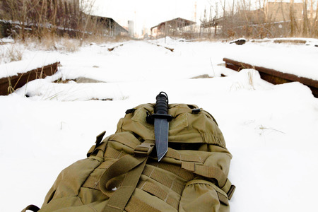 Tactical knif on sand back pack. Stock Photo