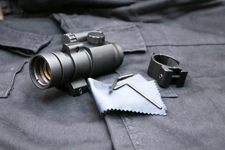 Sight for tactical weapons. Collimator sight. Black background. 版權商用圖片