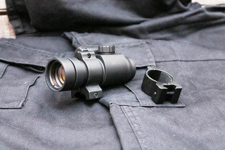 gunsight: Collimator sight closed type. Military ammunition. Black background.