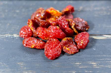 Handful of dried dogwood. Dried berry kizil. Healthy
