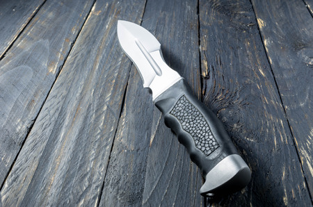 Military knife with black handle of leather. Stock fotó