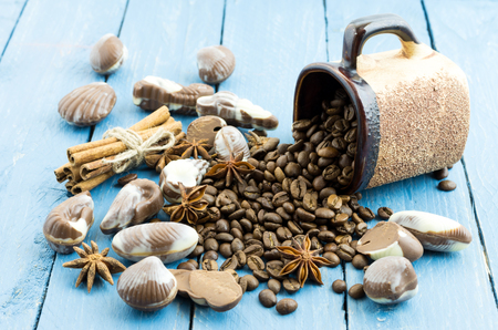 Coffee chocolate composition. Cinnamon sticks, coffee beans and chocolate. Stock Photo