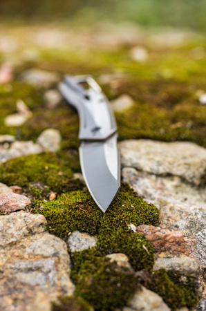 The knife is inclined. Photo knife in nature. Stock Photo