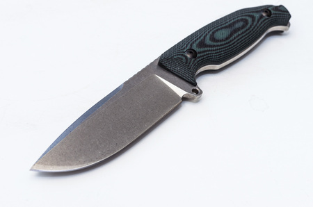 A big military knife. A knife is a weapon. Knife on a gray background.