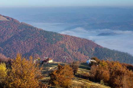 Mountain autumn landscape. The mountain range. Autumn in the mountains. A place for tourists. Carpathians. Ukraine.