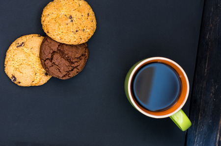 Breakfast with coffee and gingerbread. Top view. Lie flat on a black background.