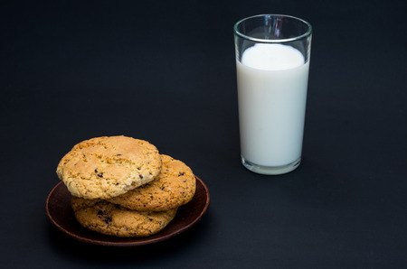 Homemade cookies and homemade milk. Healthy breakfast. Composition in a low key. Stock Photo