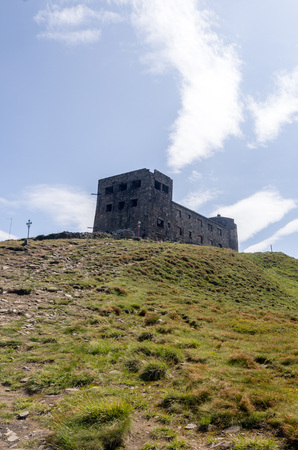 The fortress on top of the mountain. Vertical shot. Meteorological station. 版權商用圖片