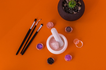Home pot with cactus on the make-up table. Flat lie. Reklamní fotografie